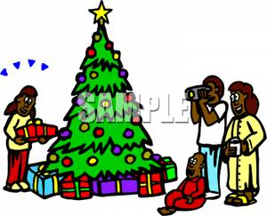 300x243 African American Family Gathered Around A Christmas Tree Clip Art