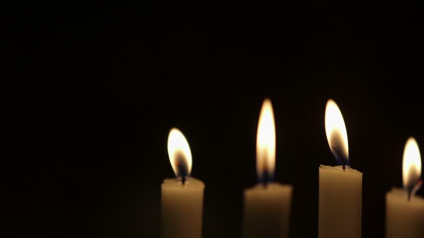 852x480 Rack Focus On Lit Candles. Rack Focus On Lit Candles Against Black