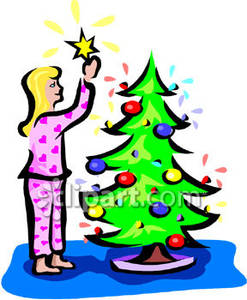 247x300 In Pajamas Putting The Star On Top Of Christmas Tree Royalty Free