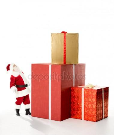 380x450 Santa Claus With Pile Of Christmas Gifts Stock Photo