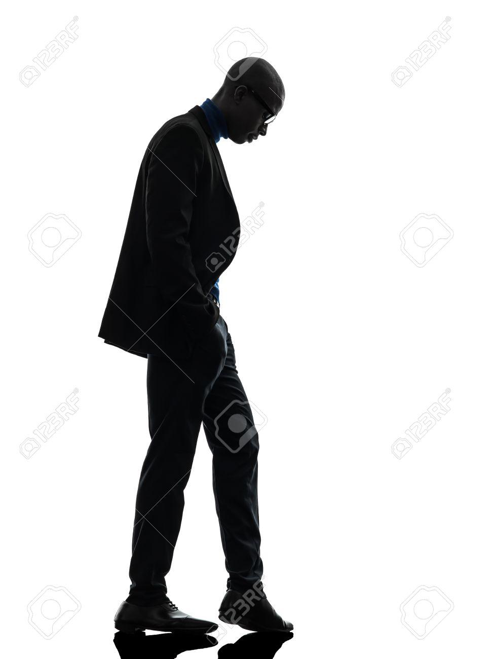 971x1300 One African Black Man Standing Looking Down In Silhouette Studio