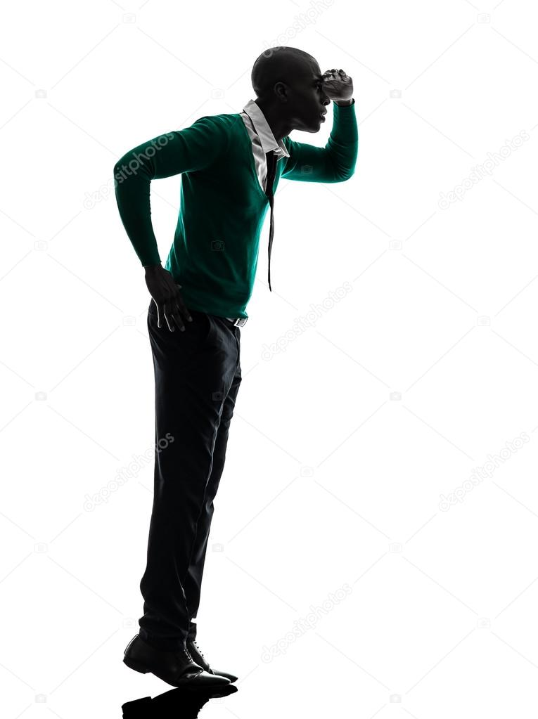 765x1023 African Black Man Standing Tiptoe Looking Away Silhouette Stock