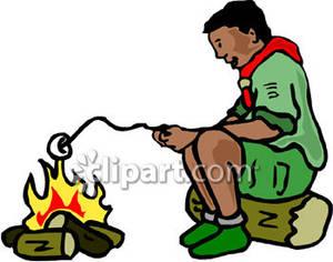 300x236 Boy Roasting A Marshmallow Over A Campfire