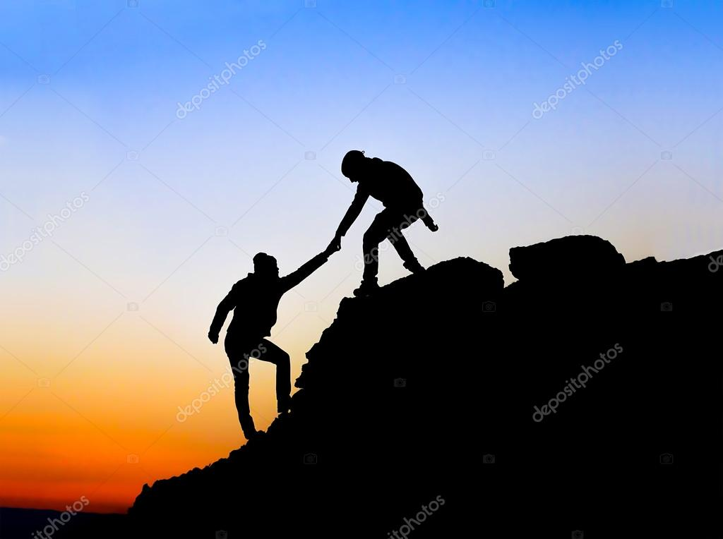 1024x764 Silhouette Of Helping Hand Between Two Climber Stock Photo