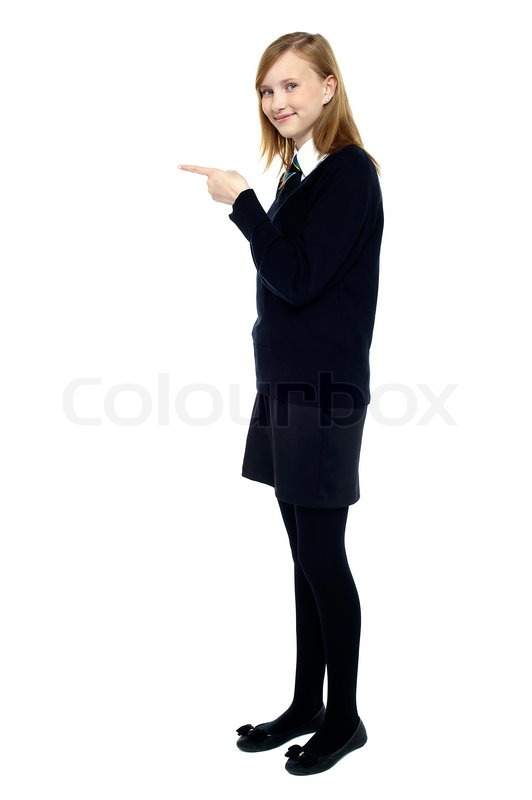 532x800 Student Standing Sideways And Pointing Forward Stock Photo