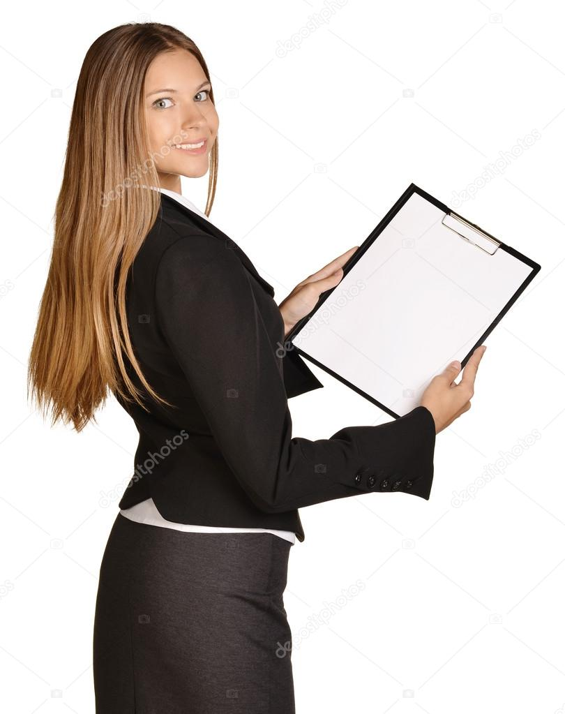 810x1023 Business Woman Standing Sideways And Holding In Hands Clipboard