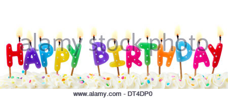 450x196 Birthday Cake With Candles And The Words Happy Birthday Sam Stock