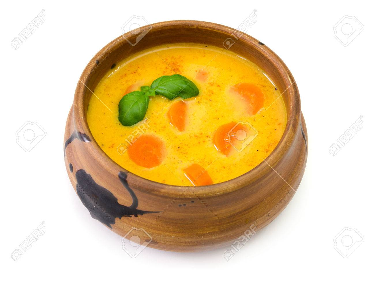 1300x974 A Soup Bowl Of Carrot Soup With Basil Leaves On White Background