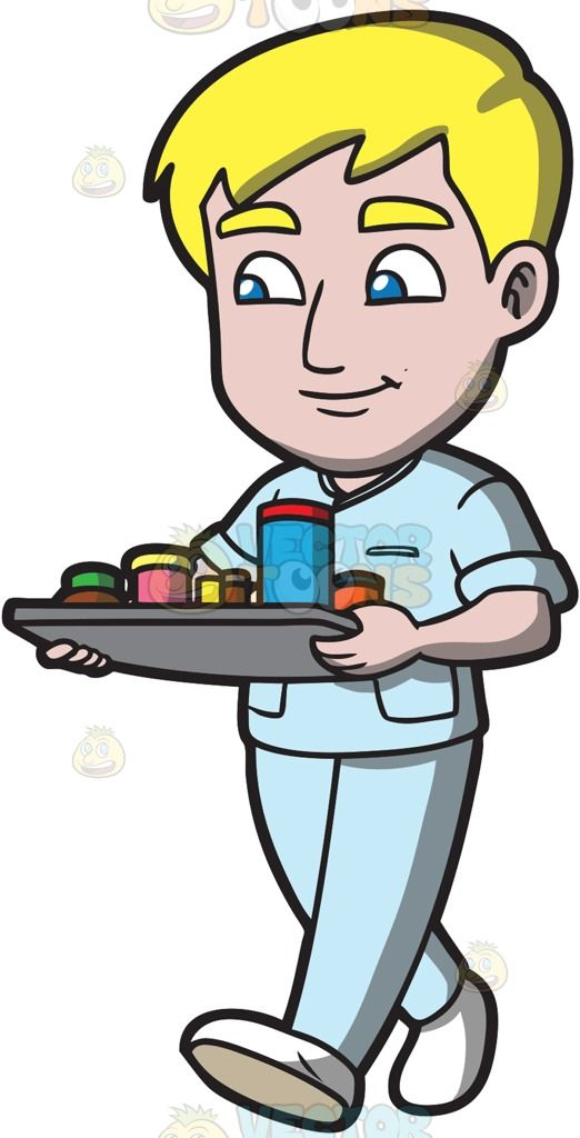 522x1024 Young Man Wearing Scrubs Standing With His Hands On His Hips