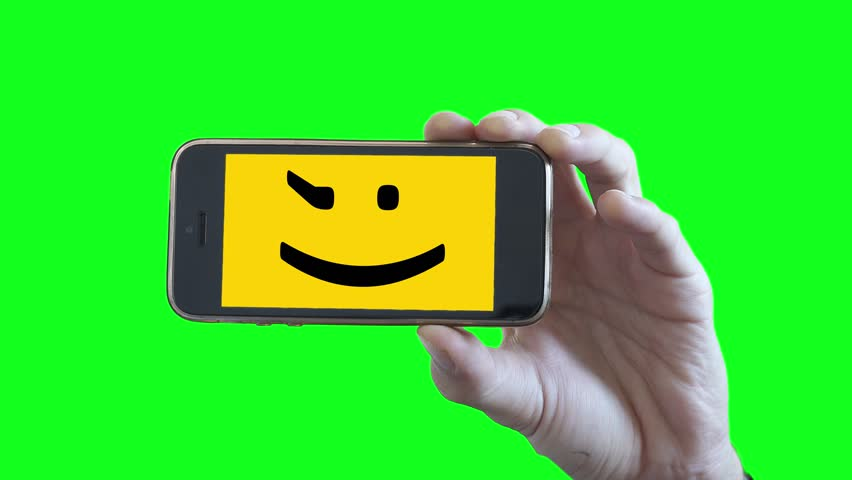852x480 Smiley Face Smartphone On Green Screen Background. Male Hand