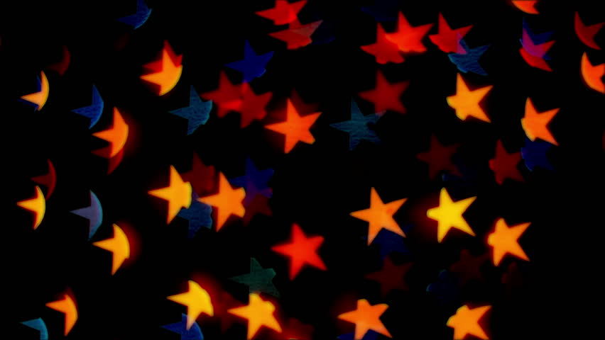 852x480 Animated Falling And Spinning Golden Stars Against Transparent